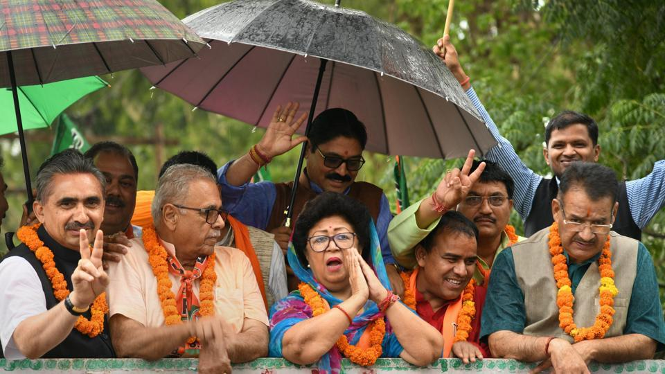 BJP  candidate from Tehri seat Mala Rajya Laxmi Shah with state minister Dhan Singh Rawat and city mayor Sunil Uniagal Gamma in a roadshow after her victory in the Lok Sabha elections, in Dehradun, Friday, May 24, 2019.