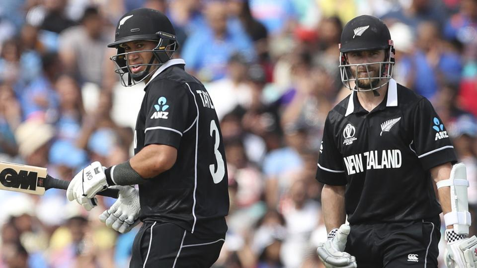 New Zealand captain Kane Williamson, right, watches as teammate Ross Taylor celebrates scoring fifty. (AP)