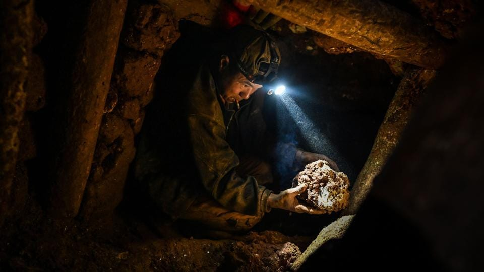 """Sometimes you hit another tunnel when you're digging underground,"" one miner, asking not to be named, covered in mud and kitted out with head torch and walkie-talkie. Tunnel collapses are a constant threat in this scramble for riches, and the start of the rainy season only ups the risk. (Ye Aung Thu / AFP)"