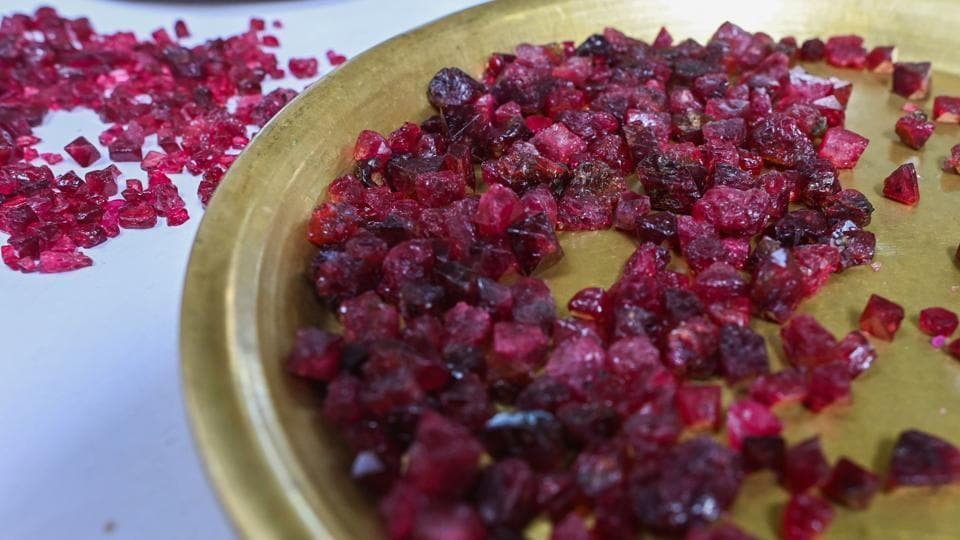 Rough rubies displayed at the gems market. High-value rubies are often smuggled over the border into Thailand or China to be sold directly to private buyers or made into jewellery. Many of the remainder end up at Mogok's market, where dealers using torches and magnifying glasses scrutinise small mounds of the gemstones. (Ye Aung Thu / AFP)