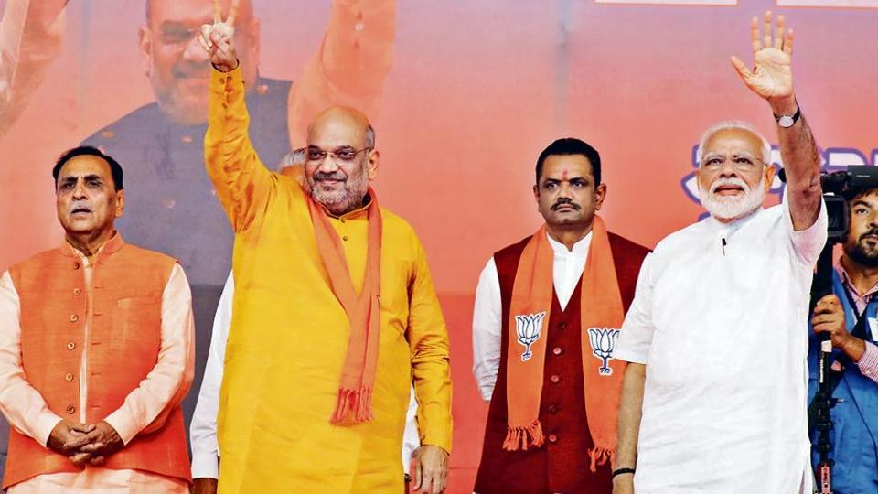 Prime Minister of India Narendra Modi (R) and Bharatiya Janata Party (BJP) president Amit Shah wave at supporters during a public meeting, in Ahmedabad, Gujarat, on May 26, 2019. (Siddharaj Solanki / Hindustan Times)