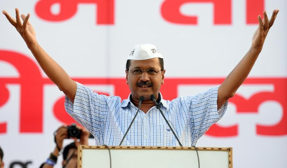 Delhi Chief Minister Arvind Kejriwal addresses the crowd during a public meeting of AAP workers at Punjabi Bagh Club in New Delhi on Sunday.