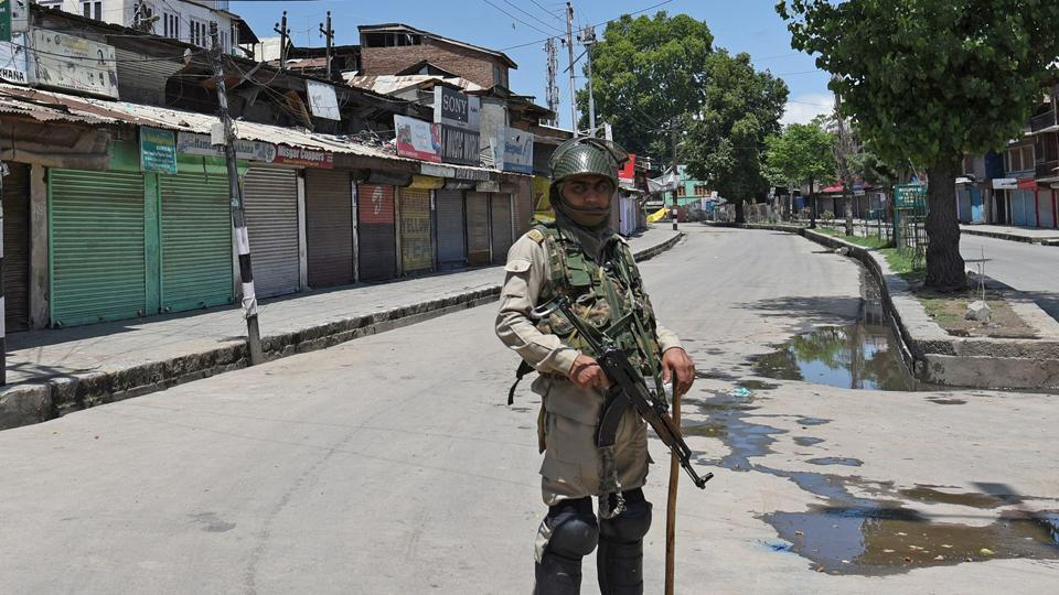 Paramilitary soldiers stood guard during restrictions in downtown Srinagar, Jammu and Kashmir, India on Friday. Authorities imposed restrictions in parts of Kashmir in view of a strike called by senior separatist leader Syed Ali Geelani against the killing of Zakir Musa, a top militant commander and a civilian, Zahoor Ahmad earlier this week.