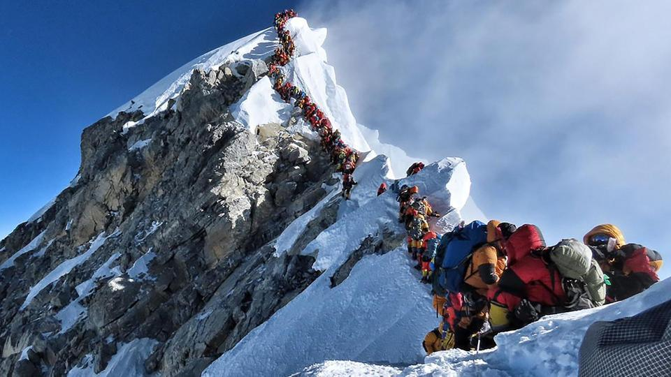 Photos of long queues near the summit have been widely shared as record numbers ascended the mountain in May.