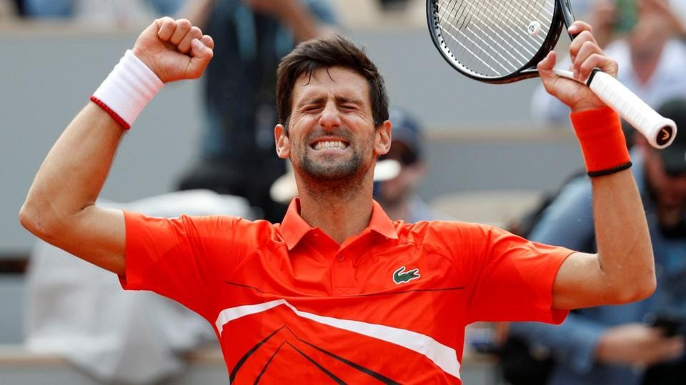 Novak Djokovic celebrates after winning his first round match against Poland's Hubert Hurkacz in the French Open.