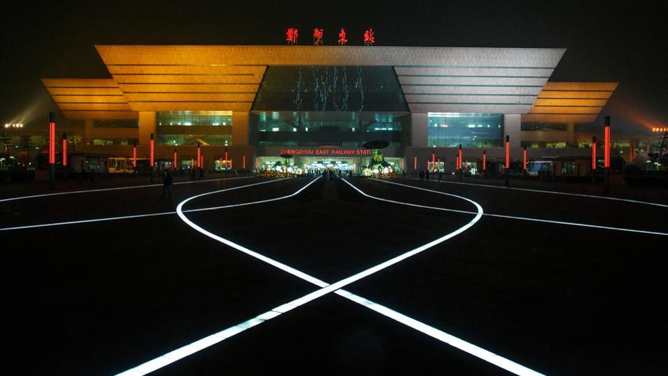 LED lights illuminate the pavement square in front of a high speed railway station in the new business district of Zhengzhou, Henan province. Long a quiet provincial capital, Zhengzhou has thrived in recent years thanks to its position as a transport and logistics hub. Taiwan's Foxconn operates a factory in the city employing 230,000 people making Apple iPhones for the world. (Thomas Peter / REUTERS)