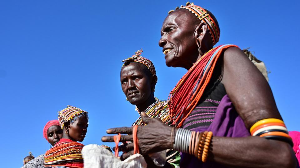 Samburu tribeswomen arrive to Merille livestock market. Lekorima, a 22-year-old herder, said advance knowledge of rainfall helped keep his people wandering far, and avoid potential tensions with distant clans. Other modern interventions are also playing a part, helping protect not just pastoralists but a sector that contributes more than 12% to Kenya's GDP, according to the World Bank. (Tony Karumba / AFP)