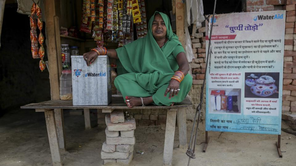 Similarly, Mohanlalganj block in Lucknow showcases another example of breaking the silence around menstruation. In a bright green sari, Krishna Devi sits in her small wooden kiosk outside her house in Lalpur village. Jars of rusks and candies are neatly placed in clear view. Devi is a 'Titli' (butterfly), a designated distributor of information as well as sanitary pads to the women of her community. (WaterAid / Dhiraj Singh)