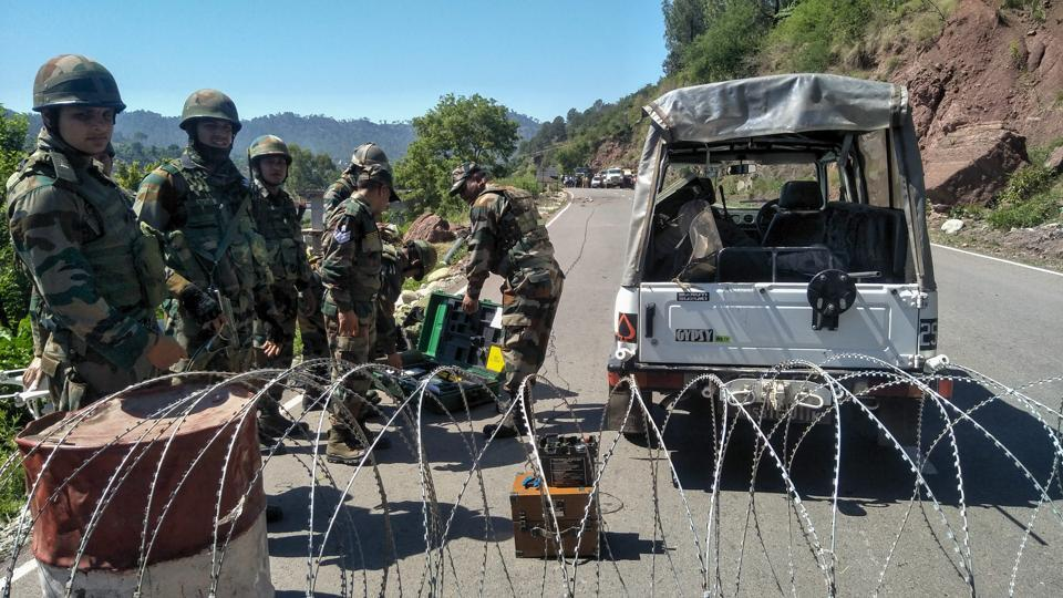 Security personnel cordon off the area where an Improvised Explosive Device was recovered at Kellar Chowk on Jammu-Poonch highway, in Rajouri district, Monday, May 27, 2019.