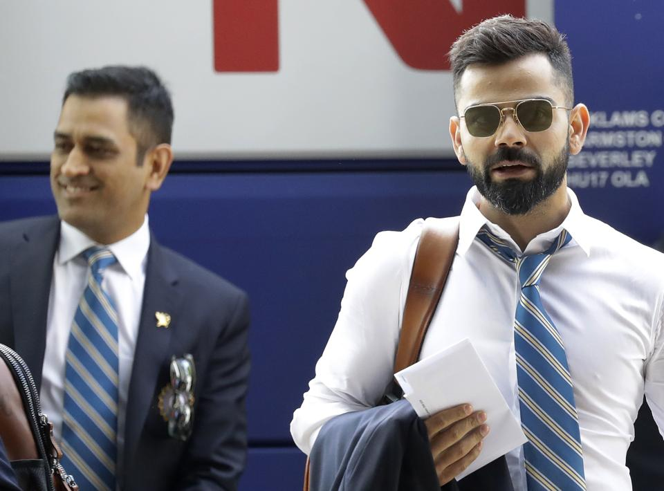 Indian cricket team captain Virat Kohli, right, and MS Dhoni arrive at the hotel in London ahead of the start of the 2019 Cricket World Cup in London, May 22, 2019.