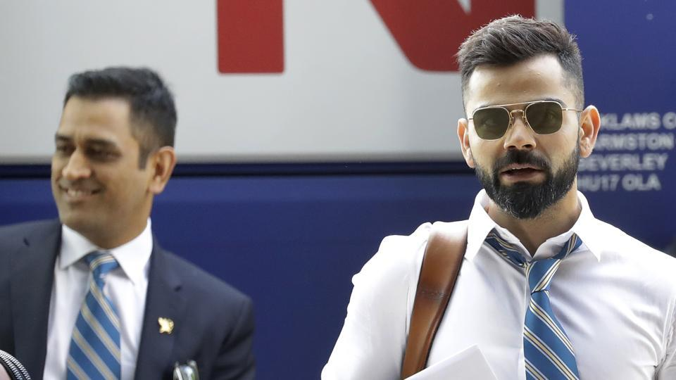Indian cricket team captain Virat Kohli, right, and MS Dhoni arrive at the hotel in London