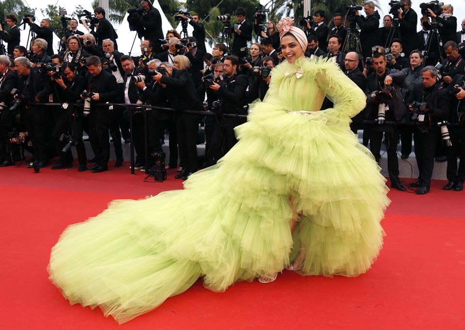 Deepika Padukone poses at Cannes in a lime green Giambattista Valli. The dress was hailed as bold, and inspired memes around the world. But if the only conversation around India is about fashion, we will be reduced to lightweights.