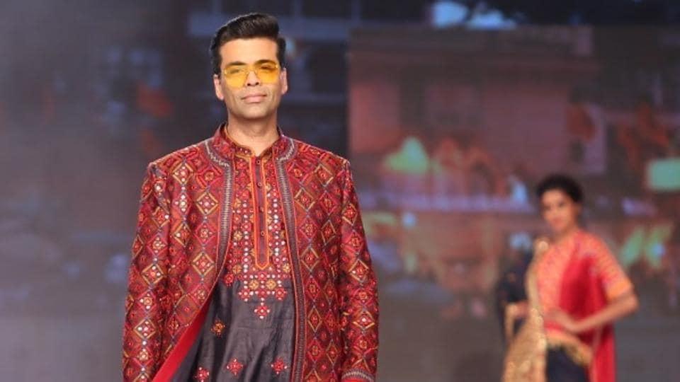 Mumbai: Filmmaker Karan Johar showcases a creation of fashion designer duo Abu Jani and Sandeep Khosla on the third day of Bombay Times Fashion Week Spring/ Summer 2019 in Mumbai, on March 25, 2019.