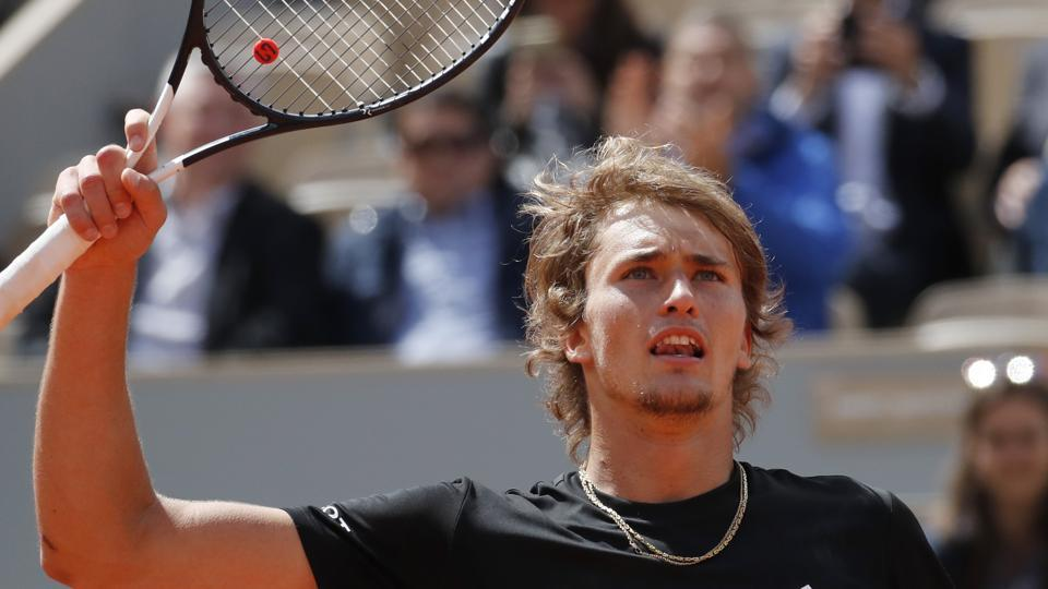 Germany's Alexander Zverev celebrates winning his first round match of the French Open.
