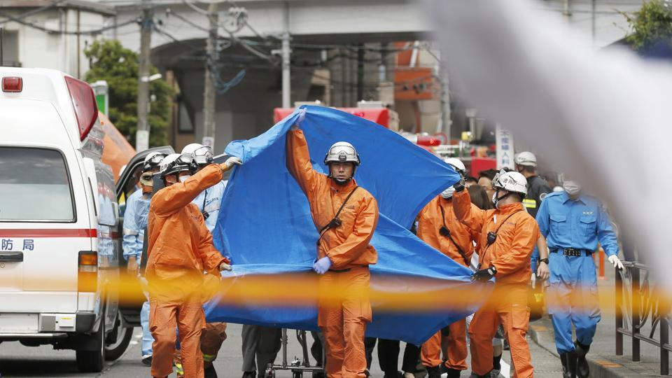 Rescuers work at the scene of an attack in Kawasaki, near Tokyo.