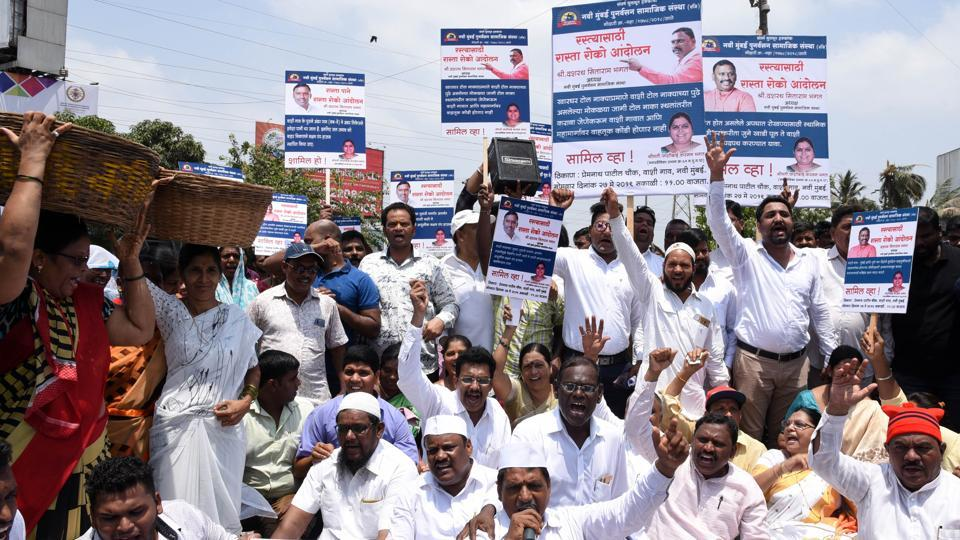 Protestors block the Sion-Panvel highway on Monday.