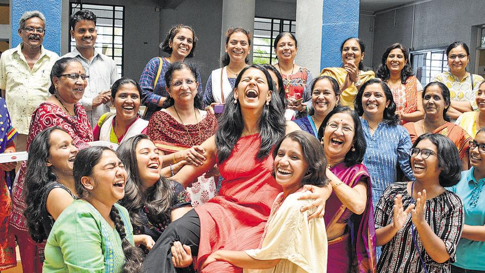 Mrinmayee Chitale (centre) scored 94.4 % in her HSC exams to top the Arts stream from Fergusson College in Pune. Here she is celebrating with friends after the results were announced on Tuesday, May 28.