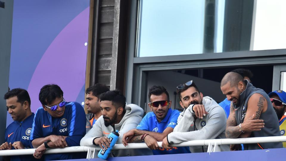India's captain Virat Kohli (2R) looks on as India's Mahendra Singh Dhoni approaches his century during the 2019 Cricket World Cup warm up match between Bangladesh v India at Sophia Gardens stadium in Cardiff