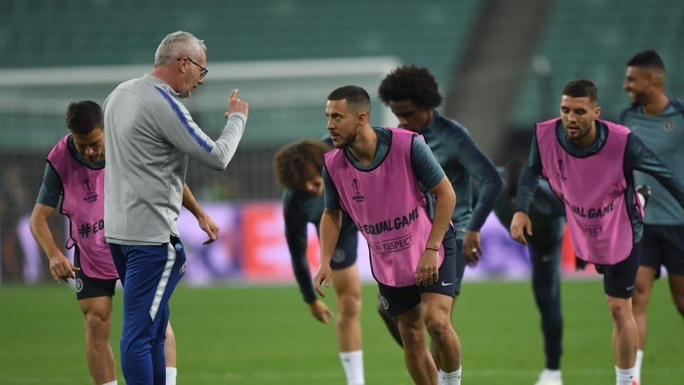 Chelsea's Belgian midfielder Eden Hazard (C) speaks with assistant coach Massimo Nenci during a training session at the Baku Olympic Stadium in Baku on May 28, 2019 on the eve of the UEFA Europa League final football match between Chelsea and Arsenal.