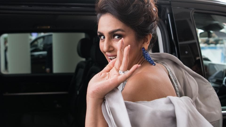 Indian actor Huma Qureshi waves as she leaves for the Festival Palace to attend the screening of the film A Hidden Life at the 72nd edition of the Cannes Film Festival.