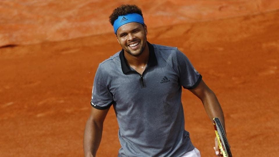 France's Jo-Wilfried Tsonga reacts during his first round match against Germany's Peter Gojowczyk