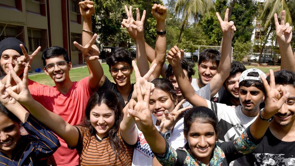 Students celebrate State Board HSC Exam Result at Fr.Agnels School Vashi in Navi Mumbai on Tuesday.