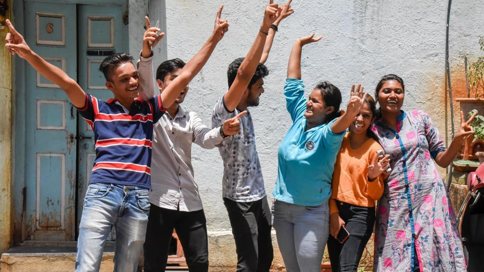 HSC students celebrating their results outside a cyber cafe in Kasba peth.
