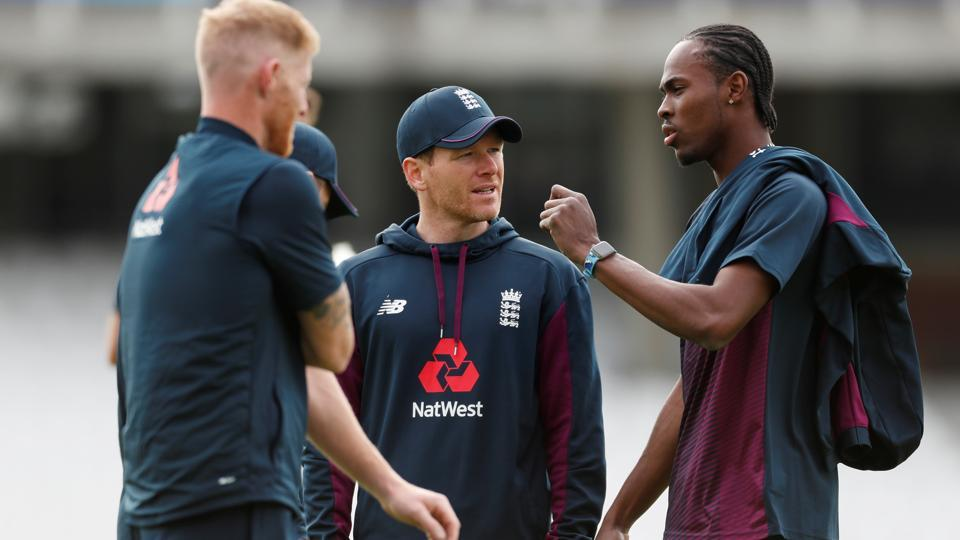 England's Eoin Morgan and Jofra Archer have a chat during a nets session.