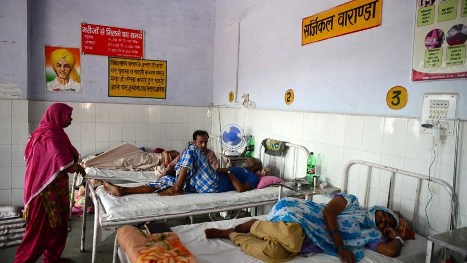 "Patients rest on beds in a hospital at Sitapur district. But the family of Vindeshwari Devi, who has had her uterus removed at the same Sitapur hospital, is satisfied. ""I think this scheme is good and it will only get better,"" said Sunil Kumar, a daily-wage labourer and Devi's son-in-law. ""For those who have nothing, it means a lot."" (Sanjay Kanojia / AFP)"
