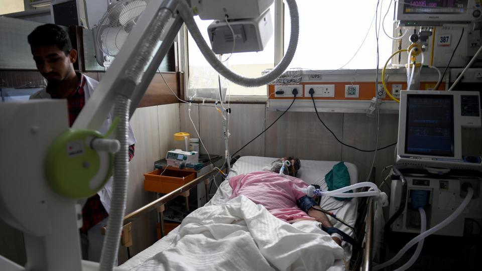"A patient in bed on a ventilator in Gurgaon. Modi's second term, however, will have to iron out some of the scheme's teething problems. ""We can't cope with (receiving) 9,000 rupees for a caesarean section which would include stay of the patient, fees of the anaesthetist, paediatrician, medicines and so on,"" said Doctor V.K. Monga from the Indian Medical Association. ""But corrective steps are being taken, "" he added. (Money Sharma / AFP)"