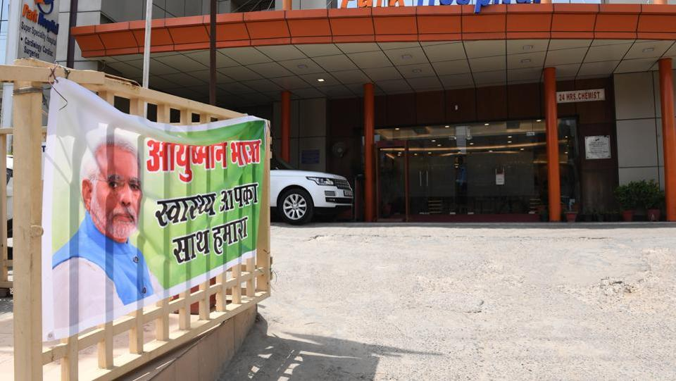 "A banner for Ayushman Bharat, commonly known as ""Modicare"" at a hospital in Gurgaon. ""It has certainly been welcomed as a welfare measure by the poor and probably contributed to electoral victory,"" said K. Srinath Reddy, president of the non-profit Public Health Foundation of India. Modicare covers hospital costs up to Rs 5 lakh for the poorest 40% of Indians, in a country where the average annual income is little above Rs 1 lakh. (Money Sharma / AFP)"
