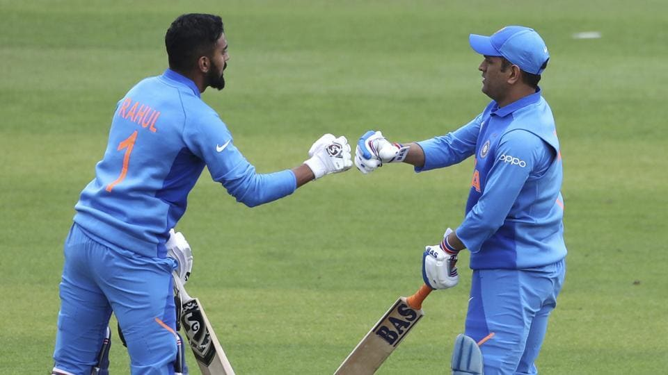 India's K.L. Rahul, left, and MS Dhoni cheer each other during the Cricket World Cup warm up match between Bangladesh and India at Sophia Gardens in Cardiff, England, Tuesday, May 28, 2019. (AP Photo/Aijaz Rahi)