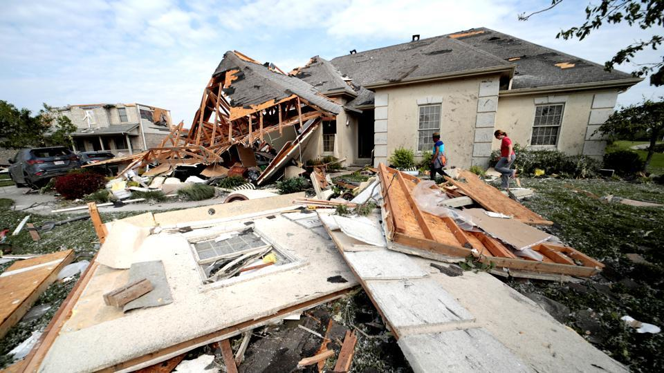 Neighbors in Clayton, Ohio gather belongings after houses were damaged after a tornado touched down overnight near Dayton, Ohio, U.S. May 28, 2019.