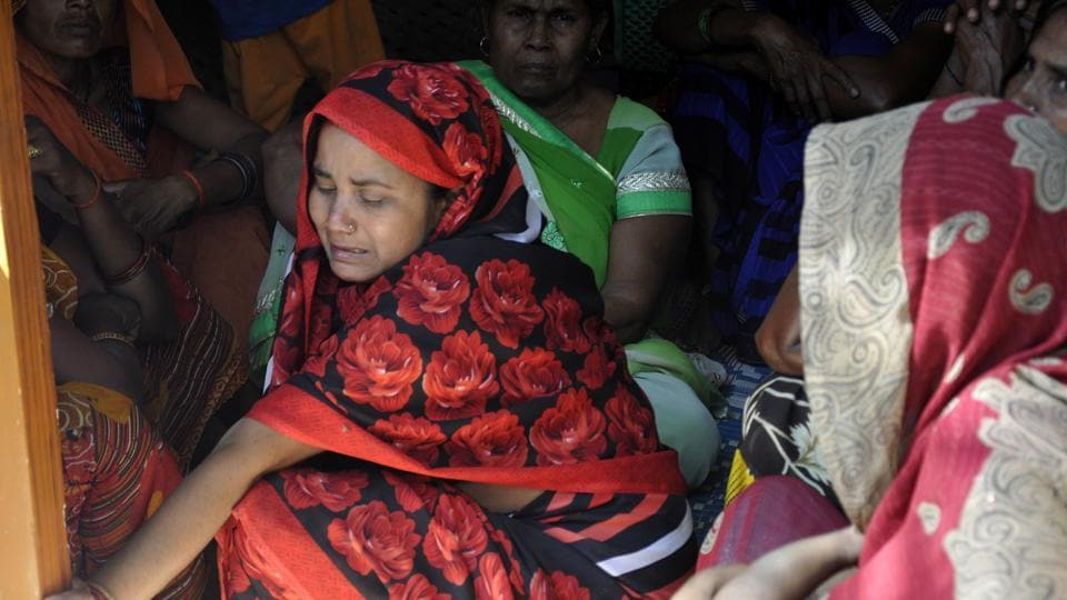 Grieving family members of one the victims of the hooch  tragedy, in Barabanki, Uttar Pradesh, on Tuesday, 28, 2019.