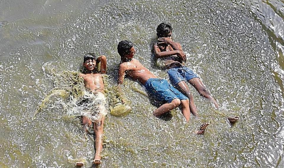 Children cool themselves off in the Yamuna on Wednesday. According to IMD, the heatwave will continue for at least a week with no respite in the form of pre-monsoon showers.