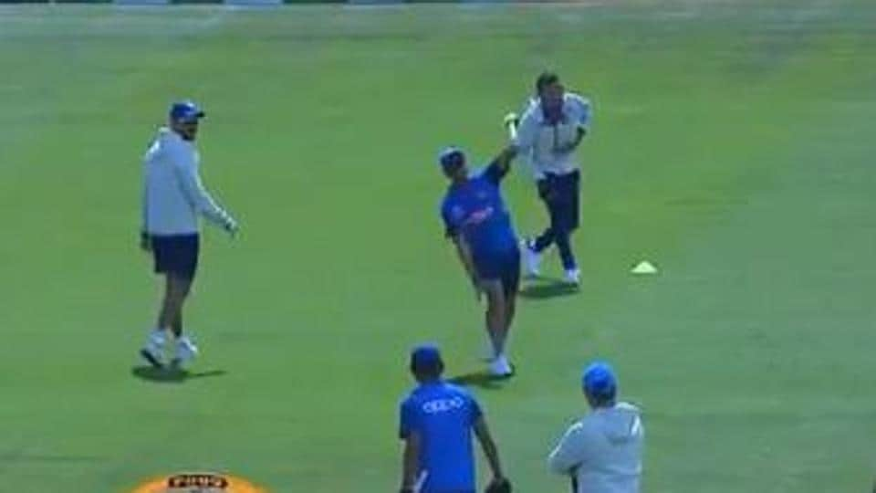 Indian players involved in a fielding drill during a practice session.