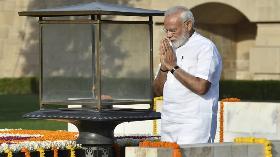 Prime minister Narendra Modi paying homage to Mahatma Gandhi at Rajghat before taking oath for his second term.