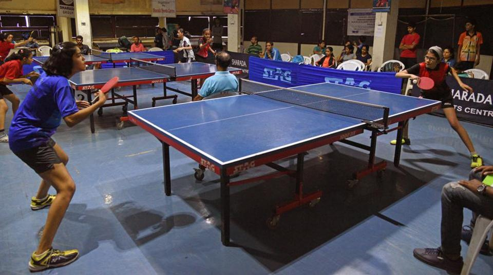 Pritha Vardikar (blue) in action at the Sharada district ranking table tennis tournament at the Sharada Sports Centre on Wednesday.