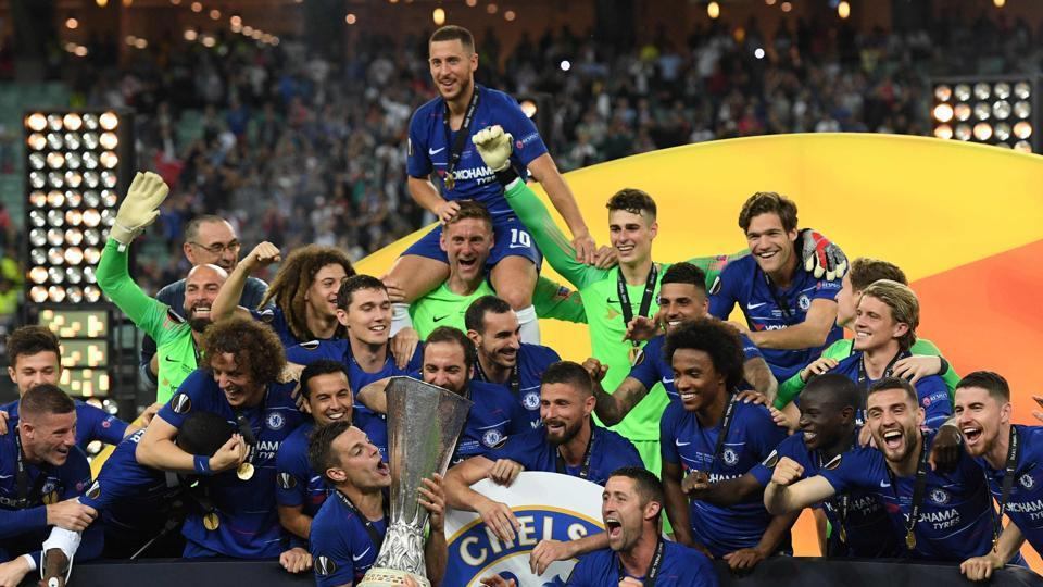 Chelsea players celebrate with the trophy after winning the UEFA Europa League final football match between Chelsea FC and Arsenal FC at the Baku Olympic Stadium in Baku, Azerbaijian, on May 29, 2019.