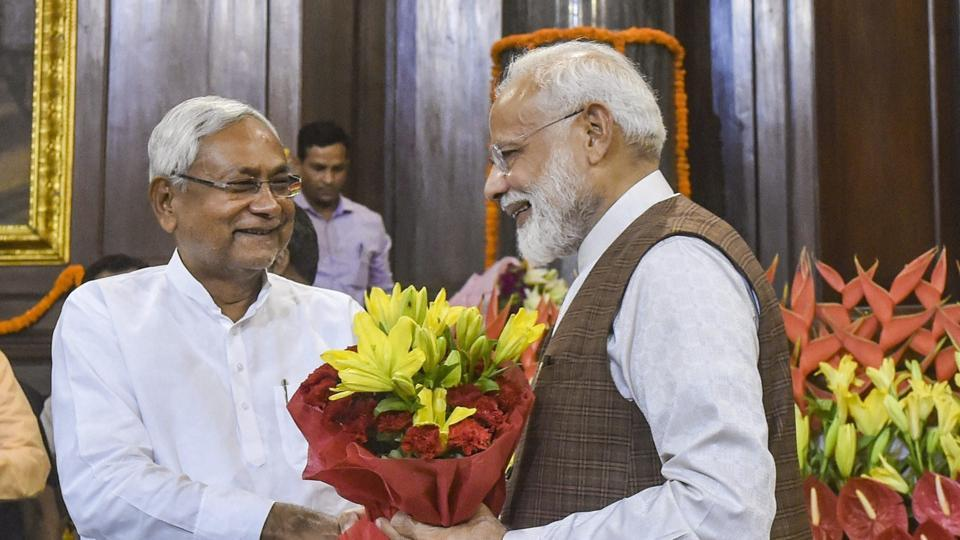 Prime Minister Narendra Modi being greeted by Chief Minister of Bihar Nitish Kumar during the NDA parliamentary board meeting, at Central Hall of Parliament House, in New Delhi, Saturday, May 25, 2019.