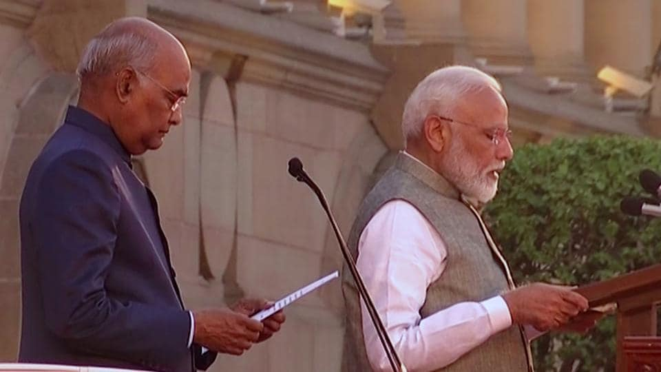 President Ram Nath Kovind administering the oath of office and secrecy to Prime Minister Narendra Modi for the second term at Rashtrapati Bhawan in New Delhi.
