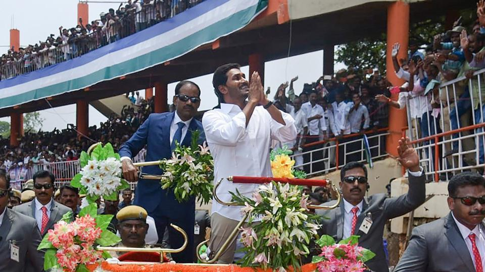 YSR Congress Party President YS Jaganmohan Reddy greets his supporters during his swearing-in ceremony as Andhra Pradesh Chief Minister, at the Indira Gandhi Municipal Stadium in Vijayawada, Thursday, May 30, 2019.