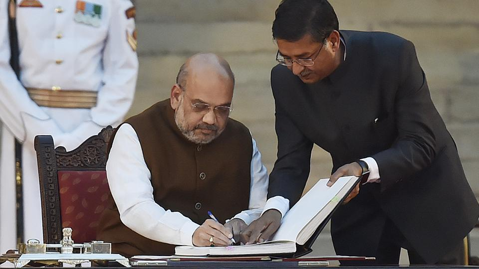 Bharatiya Janata Party (BJP) national president Amit Shah signs the documents after taking oath during a swearing-in ceremony, at the forecourt of Rashtrapati Bhavan in New Delhi, on Thursday, May 30, 2019.
