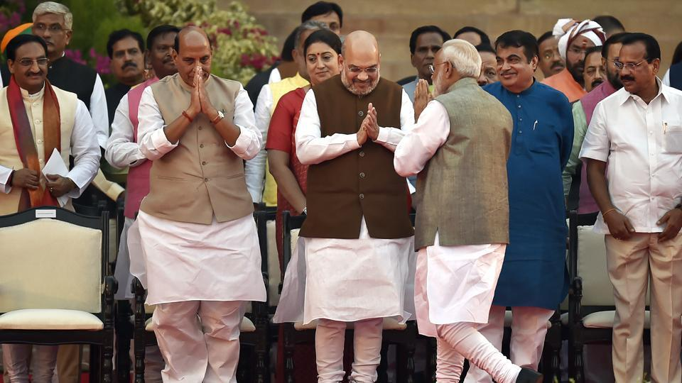 Prime Minister Narendra Modi greets Bharatiya Janata Party leaders Amit Shah, Rajnath Singh, Nitin Gadkari and others on their arrival for the swearing-in ceremony, at Rashtrapati Bhavan, in New Delhi, India, on Thursday, May 30, 2019.