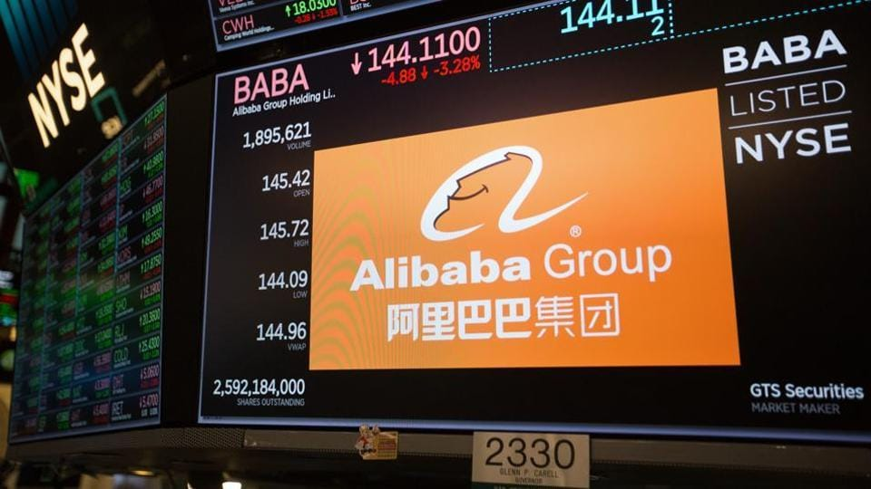 A monitor displays Alibaba Group Holding Ltd. signage on the floor of the New York Stock Exchange (NYSE) in New York, U.S., on Friday, Nov. 9, 2018. U.S. stocks slumped as investors considered what a tumble in oil prices means for the economy, while a fresh batch of weak tech earnings weighed on the high-flying sector.
