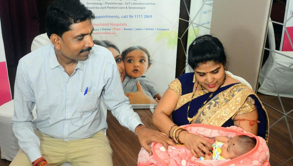 Virendra Tripathi, and Anitha Tripathi with their child Rudranksh during a press conference at Hotel Orbett in Pune