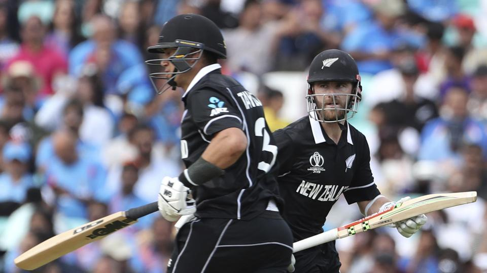 New Zealand's Kane Williamson, right, and Ross Taylor run between the wickets to score during the Cricket World Cup warm up match between India and New Zealand at The Oval in London, Saturday, May 25, 2019. (AP Photo/Aijaz Rahi)