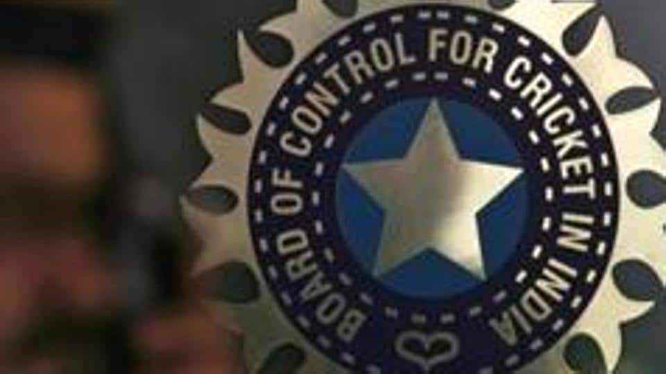 FILE PHOTO: A policeman walks past a logo of the Board of Control for Cricket in India (BCCI) at BCCI headquarters in Mumbai April 26, 2010. REUTERS/Arko Datta/Files