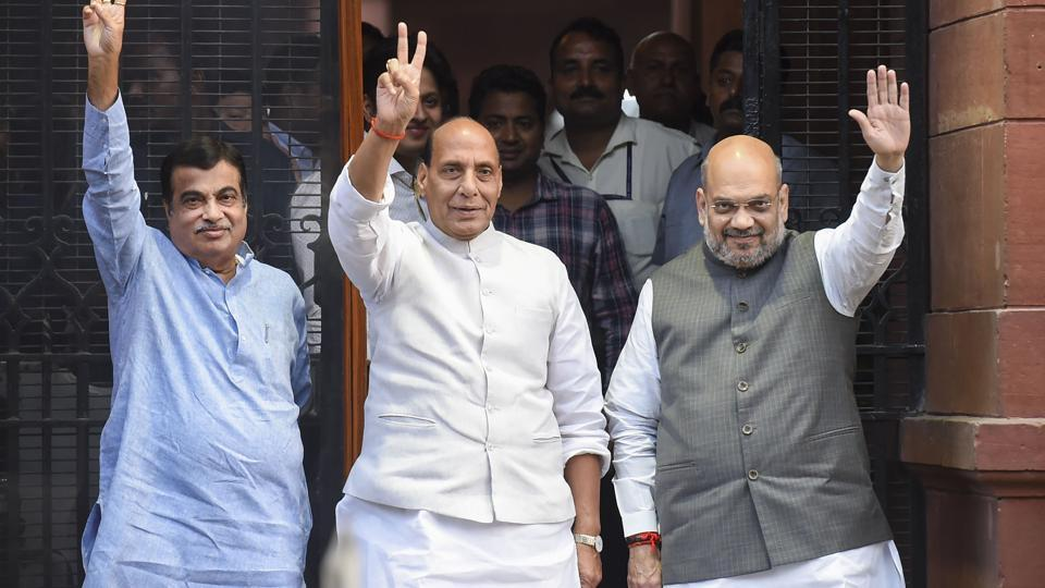 Newly-appointed Union Ministers Amit Shah, Rajnath Singh and Nitin Gadkari gesture after their first cabinet meeting under PM Modi's second tenure, in New Delhi, Friday, May 31, 2019.