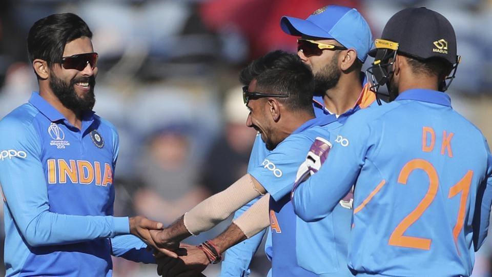 India's Ravindra Jadeja, left, celebrates with teammates the dismissal of Bangladesh's Sabbir Rahman.